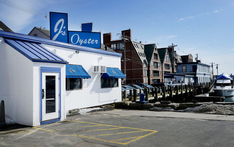 "Sitting just feet from the harbor on Portland Pier, J's is a ""sleeves rolled up, slurp some oysters"" kind of joint. And make no mistake: It is a joint."