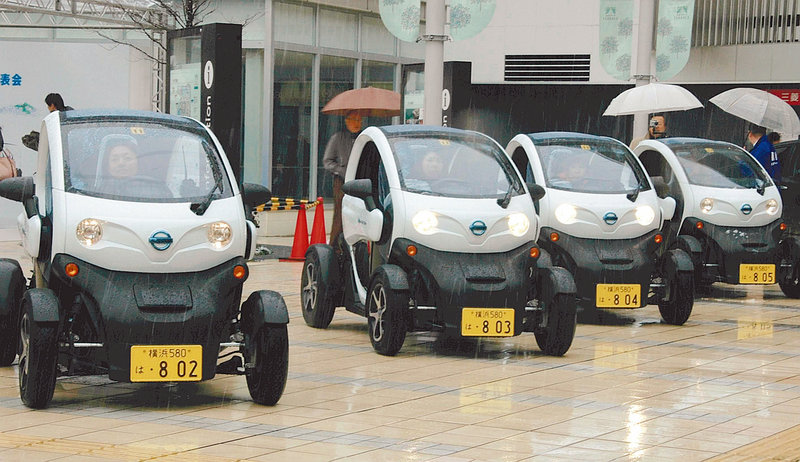 Nissan and the Japanese government are conducting a two-week trial of the ultra-minicars, with suburban families seen as a likely market down the road.
