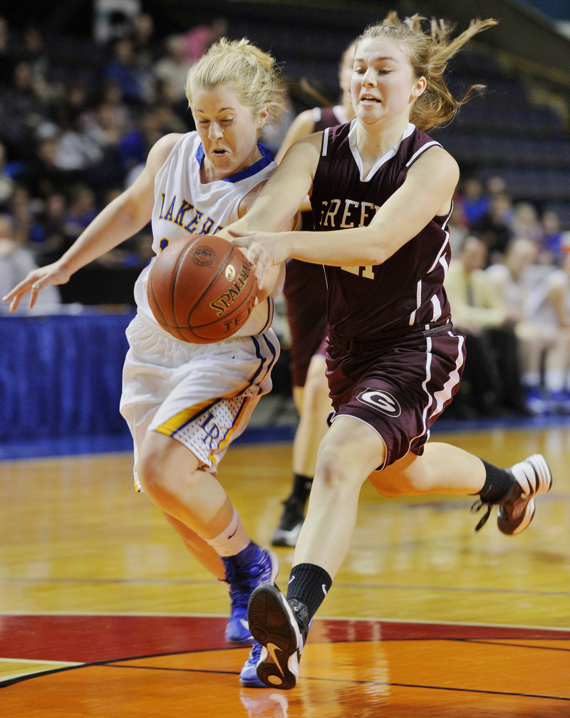 Sarah Hancock of Lake Region pokes the ball from Margaret Hatch of Greely to stop a breakaway layup during Lake Region's 42-27 win at the Civic Center.