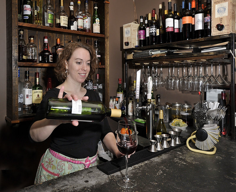 "Bartender Jenny Williamson pours a glass of Alias Cabernet during ""Wine Time,"" from 4:30 to 6 p.m., when wine specials are featured at Blue Spoon in Portland."
