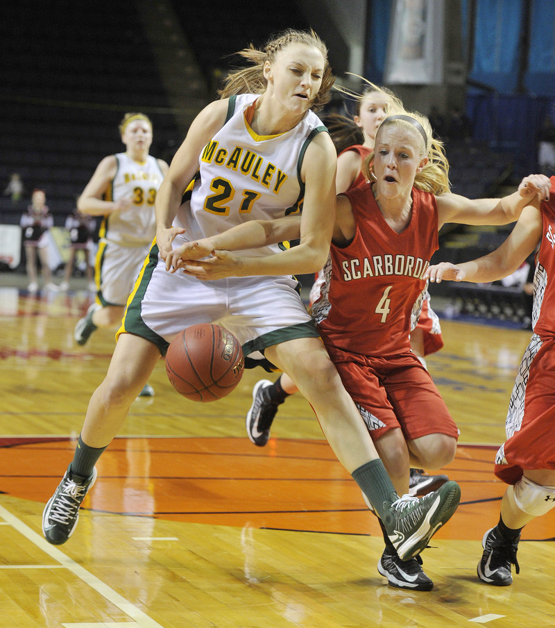 Olivia Smith of McAuley is fouled by Maria Philbrick of Scarborough, who broke up a fast break.
