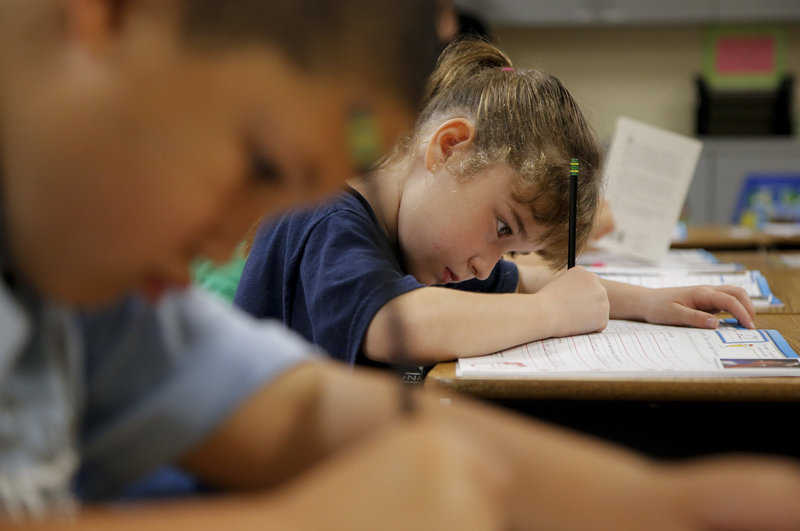 """Zoe White practices writing in cursive at St. Mark's Lutheran School in Hacienda Heights, Calif., in 2012. In North Carolina, a """"Back to Basics"""" bill would once again make cursive handwriting a part of the curriculum in state elementary schools."""