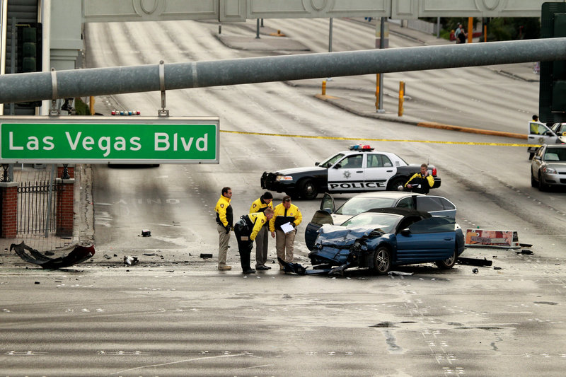 Police investigate the scene of a car accident in Las Vegas on Thursday. Las Vegas has worked to brand itself as a place where tourists can enjoy a sense of edginess with no real danger.