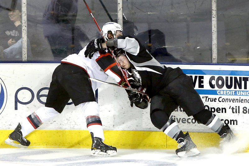 Portland's Russ Sinkewich and Manchester's Nick Deslauries aren't afraid to get their noses dirty as they clash along the boards.