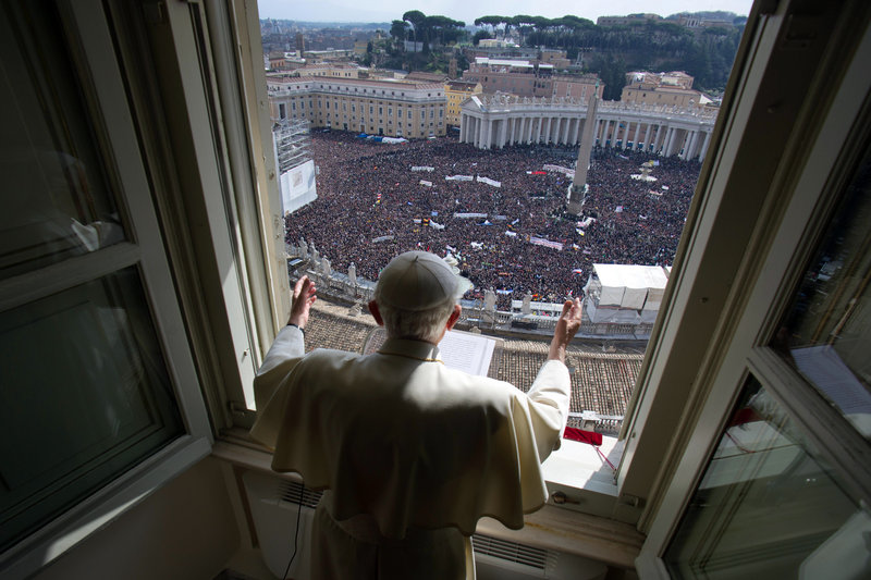 Pope Benedict XVI delivers his blessing during his last Angelus noon prayer, from the window of his apartment overlooking St. Peter's Square at the Vatican on Sunday.