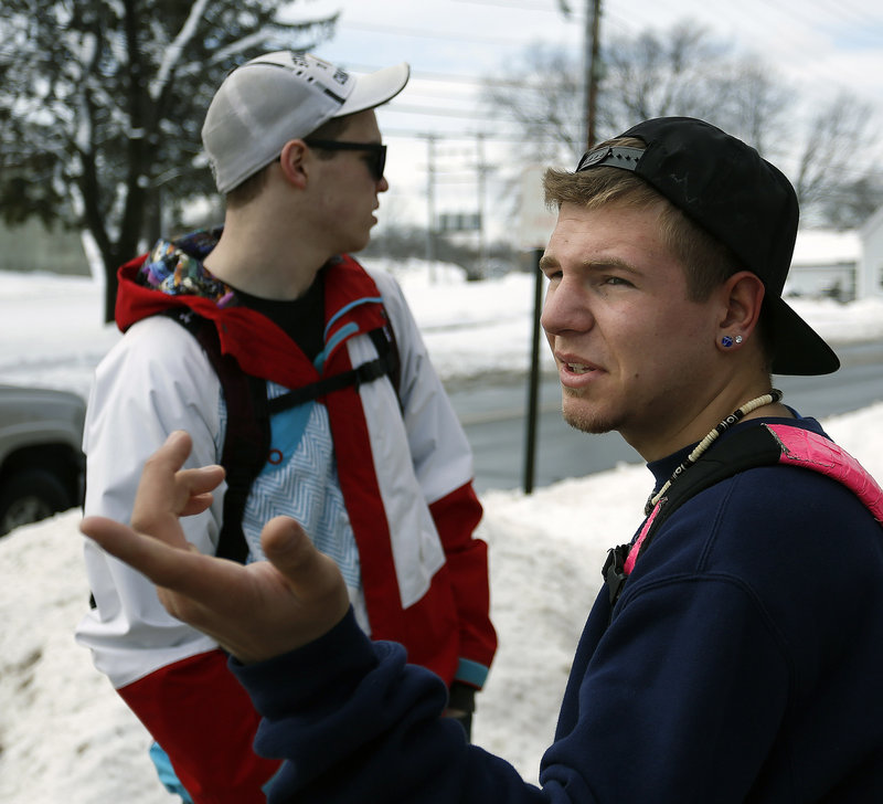 Cieran-Patrick Paterson, at right, an SMCC sophomore, looks toward a road block on Benjamin W. Pickett Street while he and his suitemate, Gavin Bourbon, a freshman, wait to re-enter their dorm after the campus was evacuated because of a bomb threat Monday morning, Feb. 25, 2013.