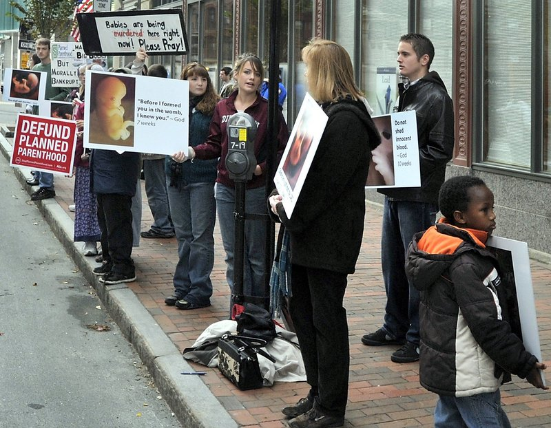 Opponents of abortion protest outside Planned Parenthood's clinic in Portland last October.