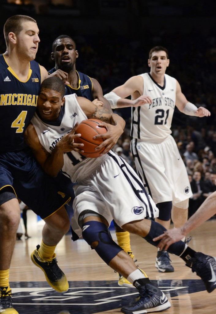 Penn State's Jermaine Marshall drives into Michigan's Mitch McGary during the first half of Penn State's big 84-78 upset of the Wolverines at State College, Pa., on Wednesday.