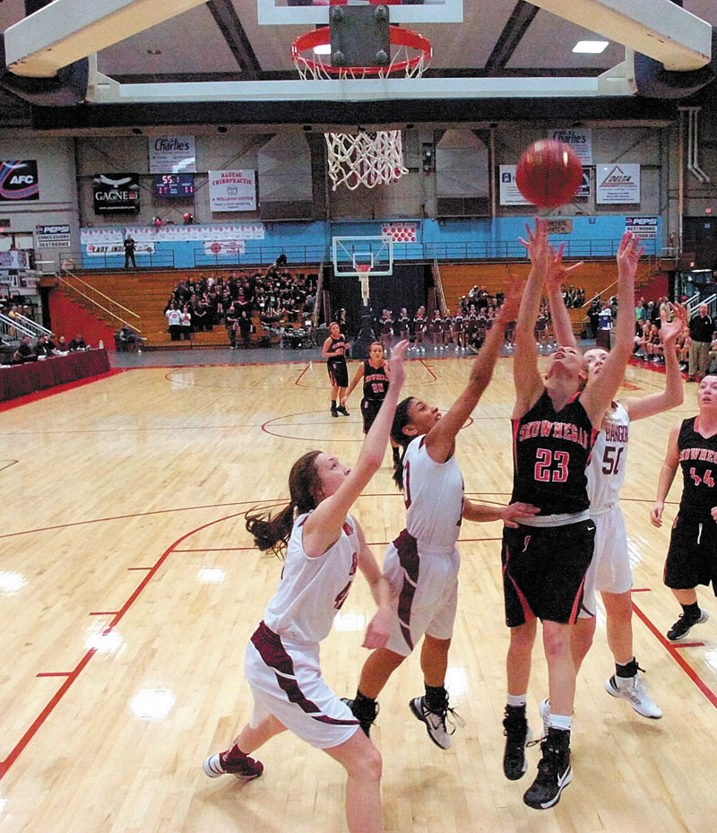 Skowhegan Area High School senior forward Adriana Martineau, 23, puts a rebound back up and in for two points during an Eastern Class A tournament game against Bangor High School on Friday February 15, 2013 at the Augusta Civic Center.