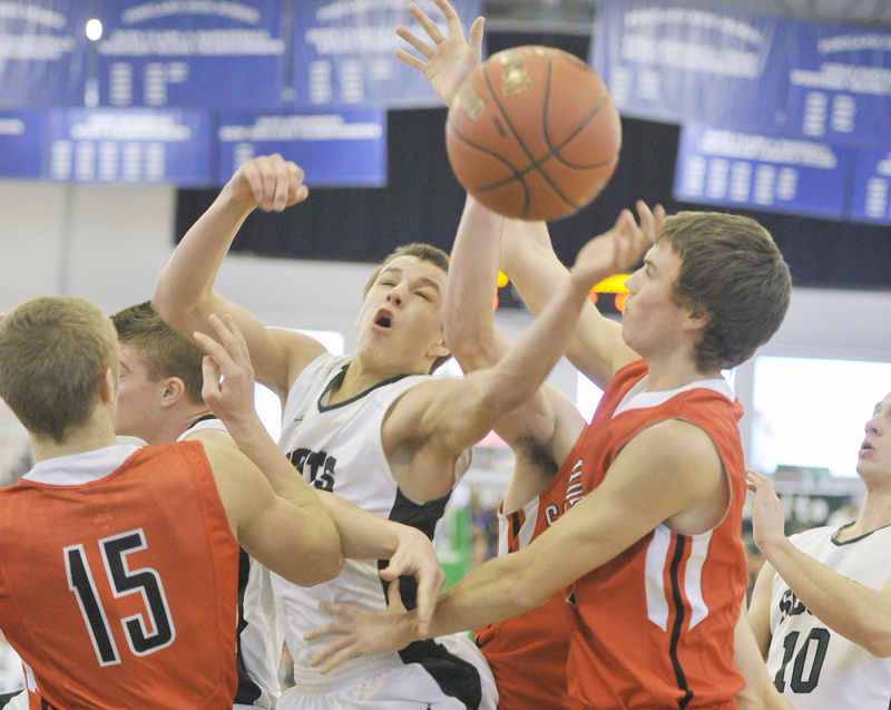 Dustin Cole of Bonny Eagle looks for a rebound between Sam Wessel, left, and Sam Terry of Scarborough during Bonny Eagle's 48-32 win in Western Class A.