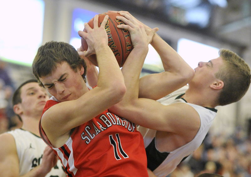 Sam Terry of Scarborough competes for a rebound with Jonathan Thomas during Bonny Eagle's 48-32 victory Saturday night at the Portland Expo. The Scots will meet Thornton Academy in the Western Class A semifinals.
