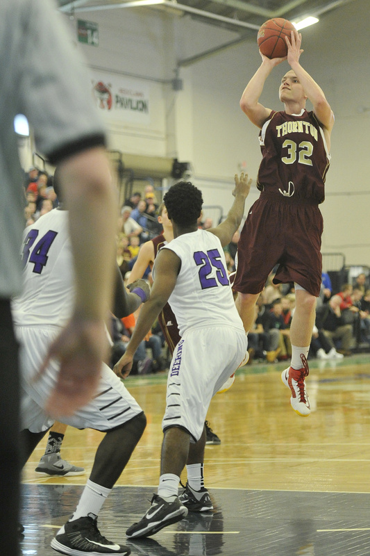 Quinn Richardson-Newton of Thornton Academy lifts a shot during the upset of Deering.