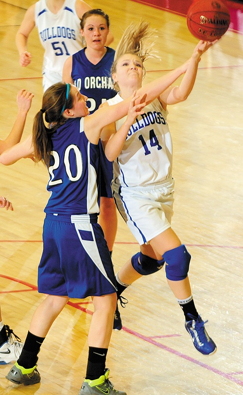 Christina Colman, left, of Old Orchard Beach fouls Cristie Vicneire of Madison at the Augusta Civic Center.