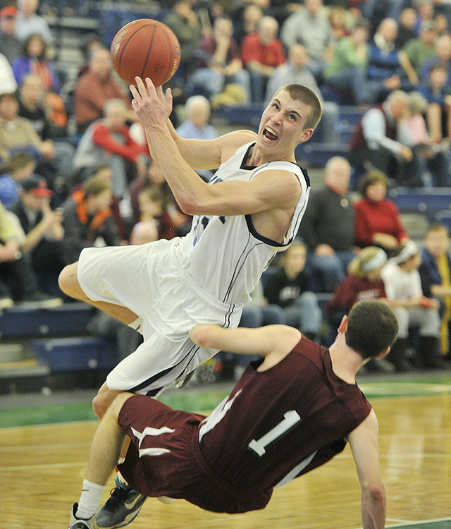 Zachary Leal of York was called for an offensive foul against Greely's Nick Dunnett, but the Wildcats still went on to beat the Rangers in a Western Class B quarterfinal.