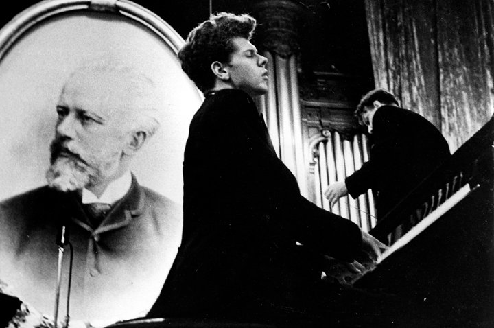 Van Cliburn performs in the Great Hall of the Moscow Conservatory in front of a picture of composer Pytor Ilyich Tchaikovsky in April 1958 during the first International Tchaikovsky Competition, which he won.