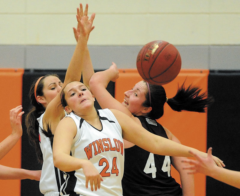 LOOSE BALL: Winslow High School's Hannah Doble (24) and Nokomis High School's Mikayla Charters (44) look for the rebound in a game earlier this season. The Black Raiders, the No. 13 seed, play No. 5 MDI in an Eastern B quarterfinal game Saturday. No. 3 Nokomis, meanwhile, plays No. 6 Belfast tonight.