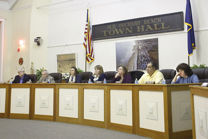 Old Orchard Beach Town Councilors, from left, Michael Coleman, Robert Quinn, Linda Mailhot, Sharri MacDonald, Laura Bolduc, Dana Furtado, and Robin Dayton listen to a resident speak during the Old Orchard Beach Town Council Meeting on Feb. 19, 2013.