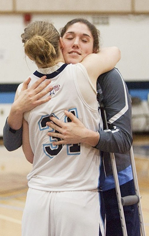 "Liz Wood, another member of the UMaine team, hugs injured Danielle Walczak after the game. ""We didn't want the season to end with (the crash),"" said Wood, a freshman from Catlett, Va. ""I'm glad we played. I didn't think about (the crash) for the whole game."" Walczak's injuries are unrelated to last week's accident."