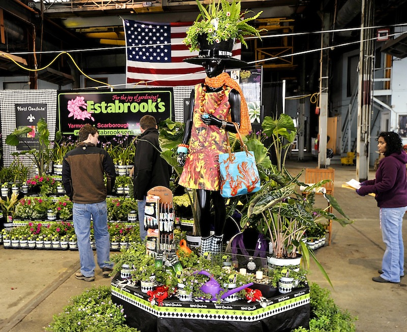 Workers check out Estabrook's display that greets visitors to the 2013 Portland Flower Show at the Portland Complex on Wednesday, March 06, 2013.