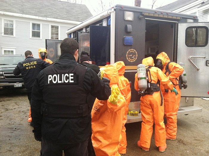 Maine Drug Enforcement Agents, along with several other agencies, search an apartment at 24 Dummer St. in Bath for a suspected meth lab on Wednesday. Photo provided by the Maine Department of Public Safety.