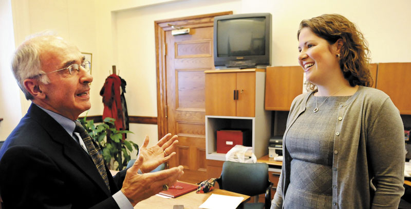 In this January 2011 file photo, then-House minority leader Emily Cain, D-Orono, speaks with Darryl Brown, former State Planning Office Director. Cain is considering running for Maine's 2nd District U.S. House seat if U.S. Rep. Mike Michaud joins the 2014 gubernatorial race.