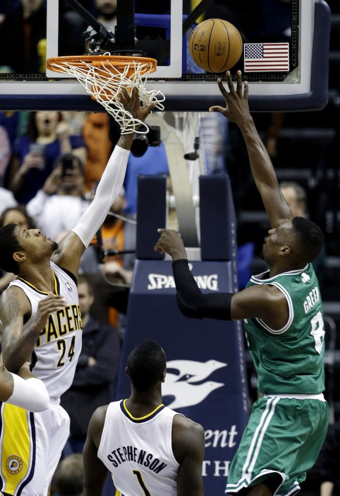Boston Celtics' Jeff Green, right, shoots the game-winning basket against Indiana Pacers' Paul George (24) and Lance Stephenson (1) Wednesday in Indianapolis. Boston defeated Indiana 83-81.