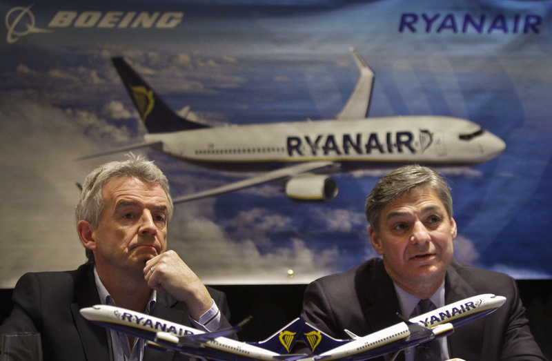 Michael O'Leary, left, CEO of Ryanair, and Ray Conner, president and CEO of Boeing, hold a news conference Tuesday in New York. Ryanair says it is buying 175 Boeing 737-800 aircraft, the biggest-ever order of Boeings by a European airline.