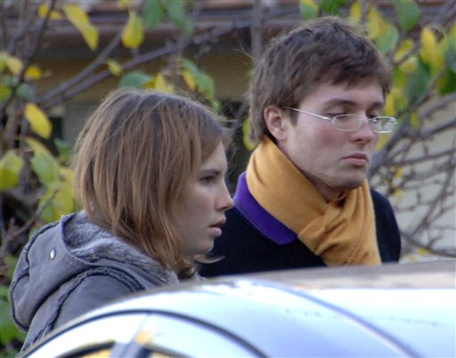 In this Nov. 2, 2007, photo, Amanda Marie Knox, left, and her then-boyfriend Raffaele Sollecito are shown outside the rented house where 21-year-old British student Meredith Kercher was found dead in Perugia, Italy.