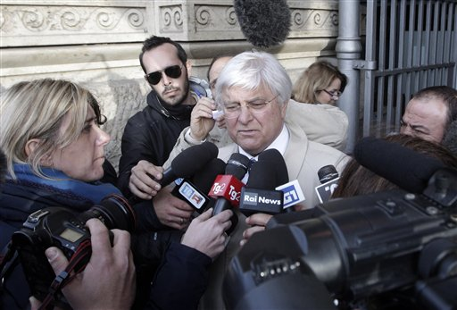 Luciano Ghirga, lawyer of Amanda Knox, center, talks to reporters in front of Italy's Court of Cassation in Rome on Monday.