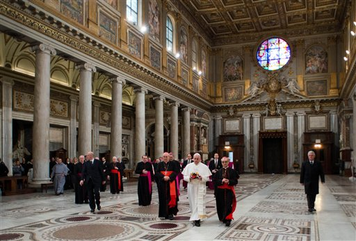 In this photo provided by the Vatican newspaper L'Osservatore Romano, Pope Francis, center, flanked at left by Cardinal Agostino Vallino, and at right by Cardinal Santos Abril y Castello, walks inside St. Mary Major Basilica, in Rome on Thursday. Pope Francis prayed at Rome's main basilica dedicated to the Virgin Mary a day after cardinals elected him the 26th pope.