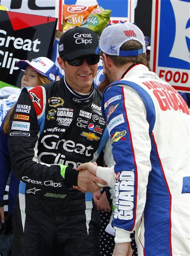 Kasey Kahne is congratulated by Dale Earnhardt Jr. after winning the NASCAR Sprint Cup Series auto race Sunday in Bristol, Tenn.