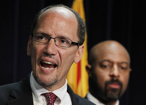 In this May 10, 2012, photo, United States Assistant Attorney General Thomas Perez, left, is joined by Deputy Assistant Attorney General for Civil Rights, Roy Austin, as Perez announces a federal civil lawsuit against Maricopa County Sheriff Joe Arpaio.