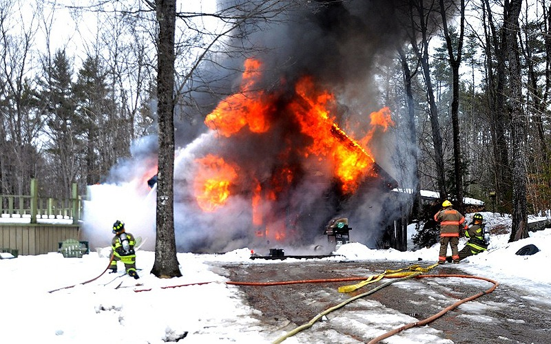 Fire destroyed a log home at 600 Naples Road in Harrison on Sunday afternoon. One person was injured in the blaze.