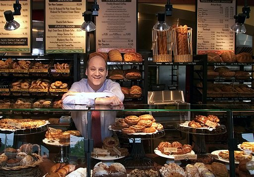Panera Bread Co. CEO Ron Shaich stands behind a counter in a St. Louis cafe. In its latest charitable venture Panera's 48 St. Louis-area cafes will offer a bowl of turkey chili for which customers will set their own price.