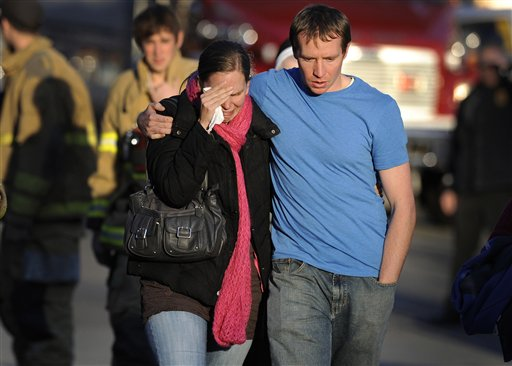 In this Dec. 14, 2012, photo, Alissa Parker, left, and her husband, Robbie Parker, leave the firehouse staging area after receiving word that their 6-year-old daughter Emilie was one of the 20 children killed in the Sandy Hook School shooting in Newtown, Conn.