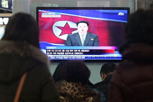 South Koreans watch a TV screen showing a North Korean state television news program on the country's nuclear test in this Feb. 12, 2013, photo.