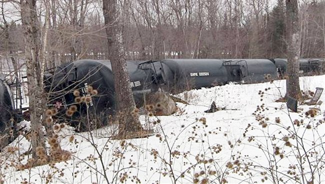 This photo provided by WABI-TV5 in Bangor shows derailed tank cars on Thursday in Mattawamkeag. Fifteen cars of a 96-car train carrying crude oil went off the tracks approximately 60 miles north of Bangor.