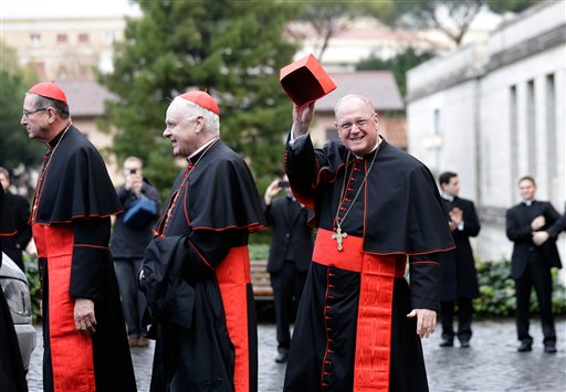 From left, U.S. Cardinals Roger Mahony, Edwin O'Brien and Timothy Dolan leave the North American College on Tuesday to go to the Vatican's Domus Sanctae Martae, the Vatican hotel where the cardinals stay during the conclave.
