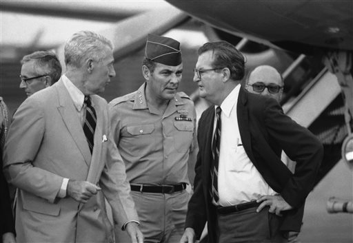 In this April 10, 1973, photo, Gen. Alexander M. Haig, center, is greeted by acting ambassador Charles Whitehouse, left, and another embassy official following Haig's arrival, in Saigon. The trip was made at the behest of President Nixon.
