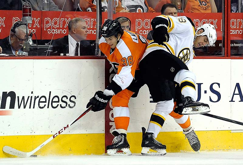 Nathan Horton of the Bruins checks Philadelphia's Oliver Lauridsen in Saturday's game at Philadelphia.
