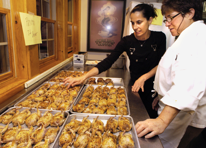Melissa Kelly of Primo restaurant in Rockland, left, and Rebecca Charles of Pearl Oyster Bar in New York prepare a course at an event held at Arrows restaurant in Ogunquit in this 2005 photo.