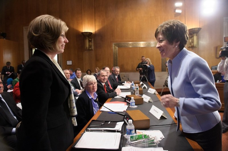 Sen. Susan Collins, R-Maine, talks with Hermon resident Kim Nichols, left, on Thursday before a hearing of the Senate Special Committee on Aging about lottery scams targeting senior citizens. Nichols' father, who lives in New Hampshire, lost $85,000 to the Jamaica-based scammers.
