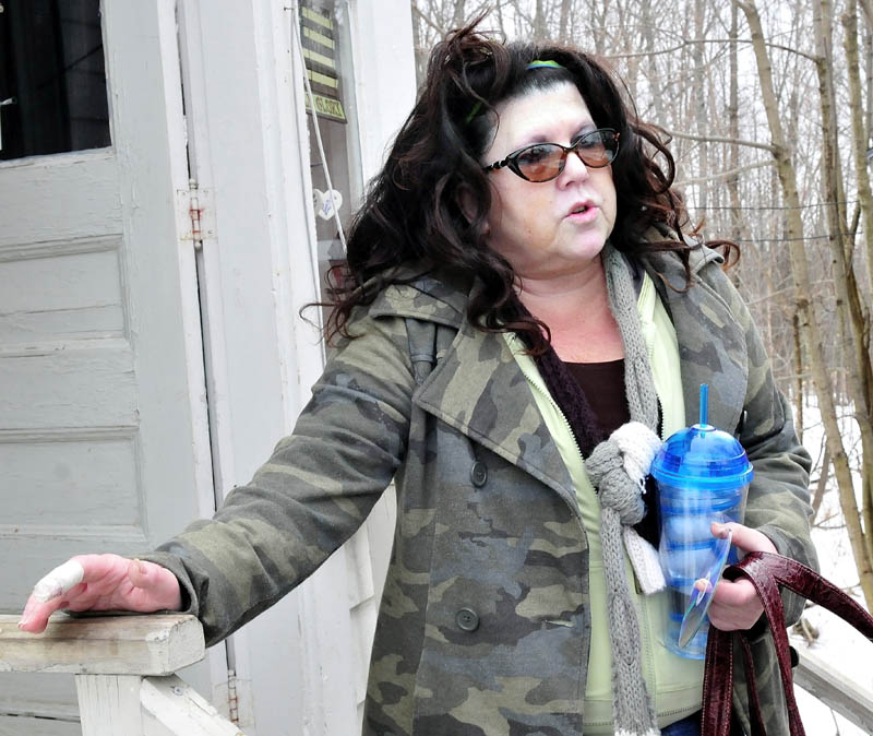 Waterville resident Kimberly Morin Brunelle on Monday speaks about living next door to the 39 Washington Street residence where 90 people, including 81 Colby College students, were summonsed for underage drinking during a party on March 9.