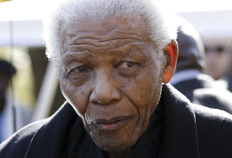 Former South African President Nelson Mandela leaves the chapel after attending the funeral of his great-granddaughter Zenani Mandela in Johannesburg, South Africa. The South African presidency says Nelson Mandela was re-admitted to hospital with a recurrence of a lung infection Thursday March 28, 2013. (2010 file photo)