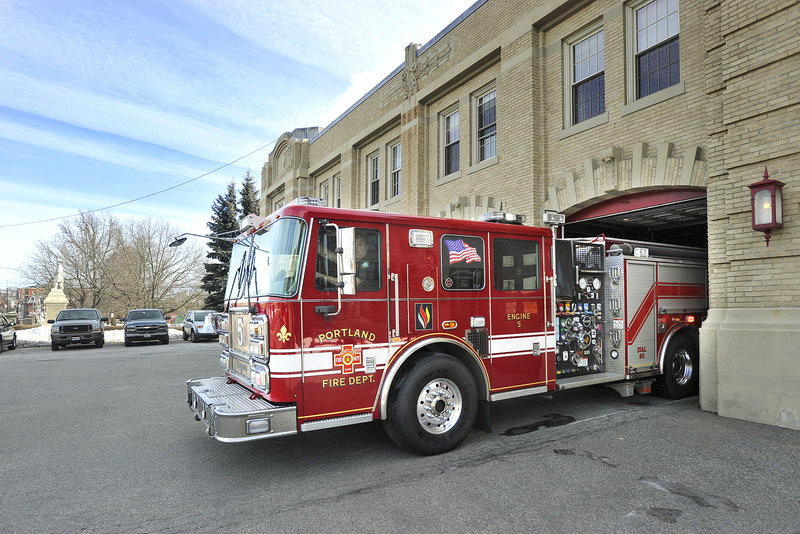 Engine 5 rolls out on a call Friday from the Central Fire Station on Congress Street in February. Portland employs 234 firefighters in seven stations, not including the fireboat quarters and air rescue unit.