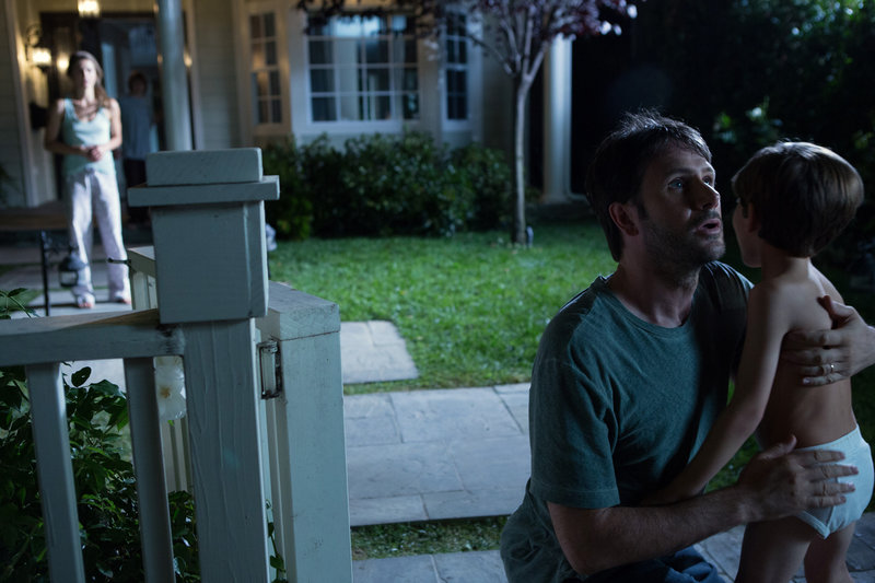 "Josh Hamilton, in a scene with Kadan Rockett, shows plenty of shock but not enough panic in ""Dark Skies."""
