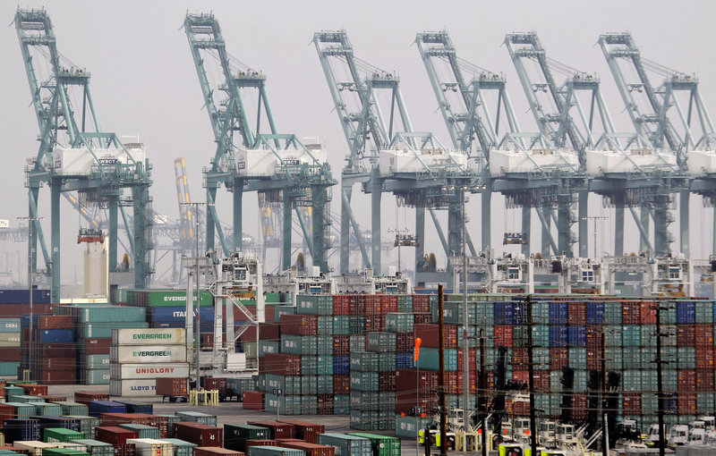 Shipping containers are seen as operations halt during a strike at the Port of Los Angeles on Dec. 4. The U.S. economy grew at a 0.1 percent annual rate in the fourth quarter.