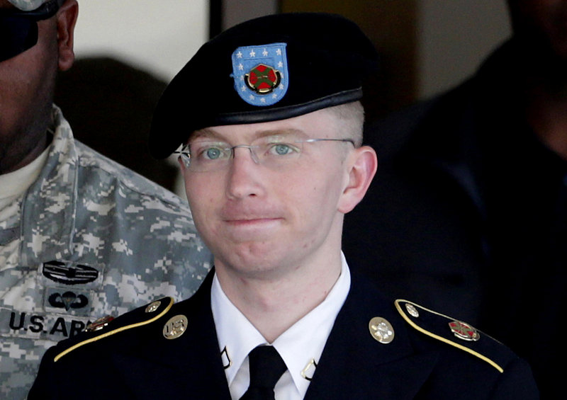 Pfc. Bradley Manning is escorted out of a courthouse in Fort Meade, Md., on June 25. Manning said Thursday he sent classified material to WikiLeaks to enlighten the public.
