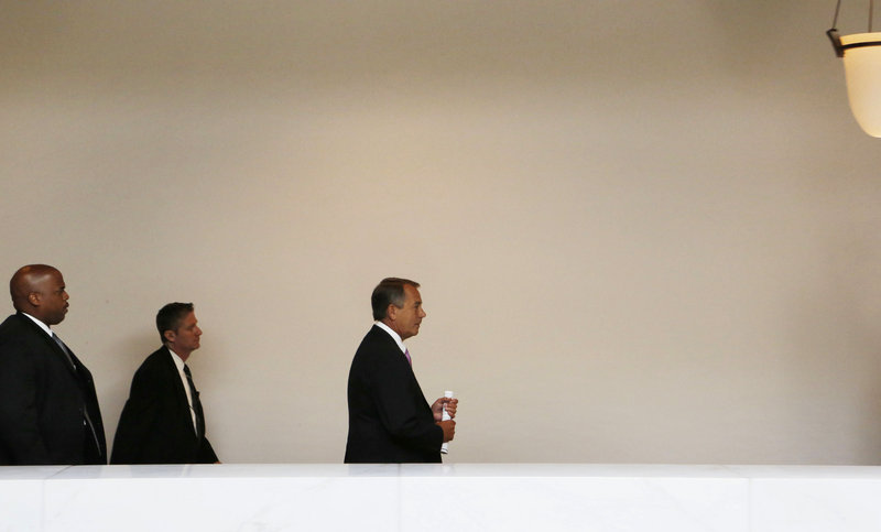 Speaker of the House John Boehner, right, walks from a news conference on Capitol Hill Thursday. Boehner, a Republican, was to meet with President Obama and other leaders Friday on the sequester issue, but no one seriously expects action.