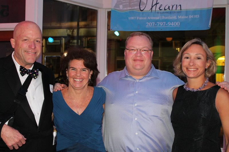 Outgoing Rippleffect board president Cyrus Hagge with board member Betsy Parker Landmann, Chris Robinson and board president-elect Katie Fulham Harris.